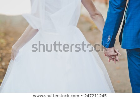 girl and  guy stand on grass having joined hands Stock photo © Paha_L