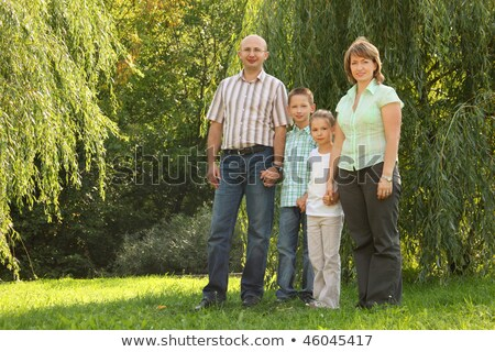 family with two children is standing near osier in early fall park stock photo © paha_l