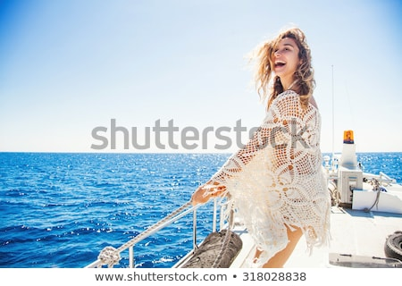 Stockfoto: Beautiful Vacationing Woman With Cruise Ship