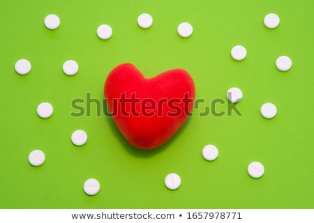 arrhythmia medical concept on green background stock photo © tashatuvango