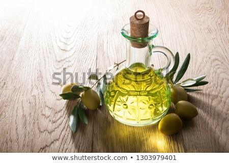 Olio d'oliva vetro jar olive verticale Foto d'archivio © marimorena