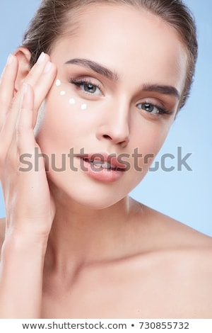 Girl with cream dots on face Stock photo © svetography