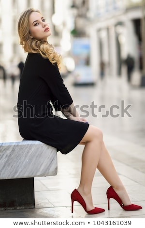 elegant lady beautiful girl model with long wavy hair sitting n stock photo © victoria_andreas