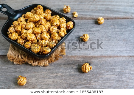 Bowl of freshly made popcorn on a picnic table stock photo © ozgur