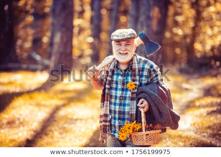 Close-up portrait of a bearded hipster guy with axe Stock photo © deandrobot