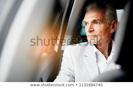 conceptual image of a handsome man sitting in the car stock photo © konradbak