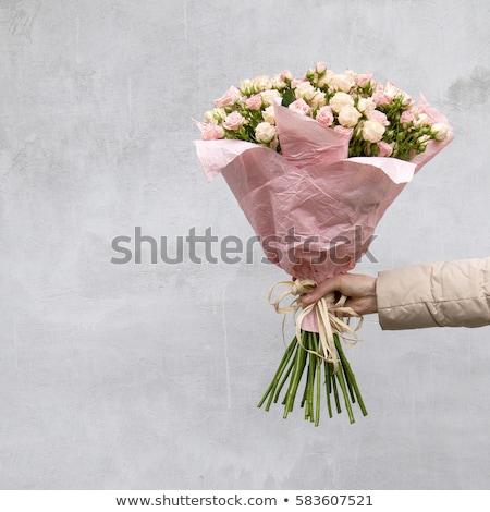 Rózsaszín rózsák kezek közelkép tart fehér Stock fotó © Lana_M
