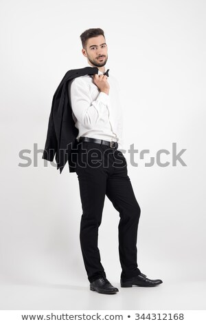 Handsome businessman holding his jacket over shoulder Stock photo © deandrobot