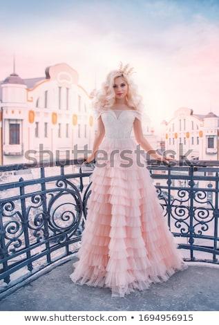 модный блондинка парик Постоянный позируют Сток-фото © deandrobot