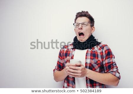 Fiatal kaukázusi beteg férfi orrot fúj papír Stock fotó © RAStudio