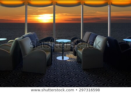 Salão navio de cruzeiro poltrona pôr do sol mar janela Foto stock © smuki