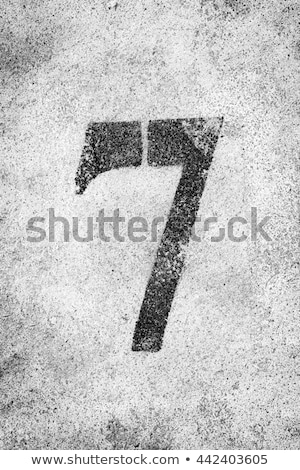 graffiti sprayed number 7 seven in black on white stock photo © melvin07