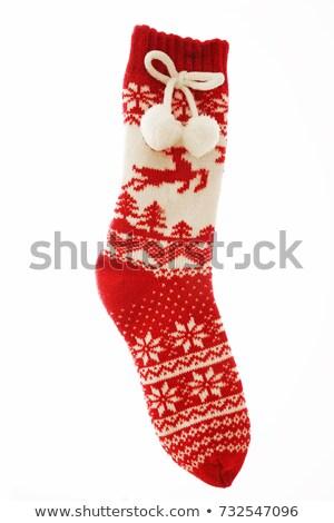 Czerwony trykotowy christmas pończocha prezenty Święty mikołaj Zdjęcia stock © orensila