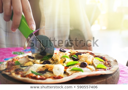 Female hand holds a slice of hot pizza Stock photo © Yatsenko