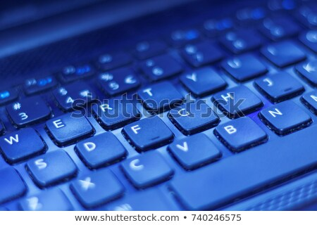 Blue enter button on black computer keyboard Stock photo © tang90246