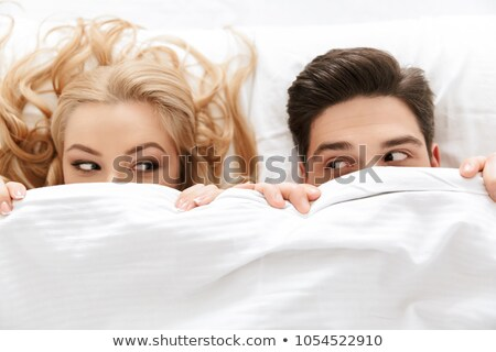 portrait of happy young couple in bed stock photo © kzenon