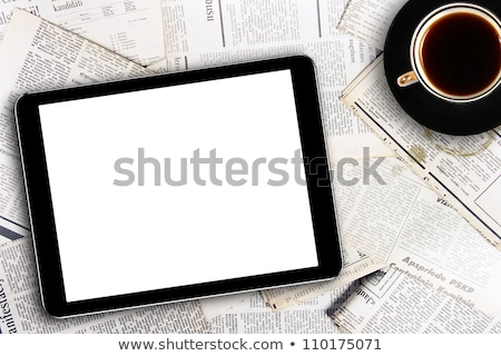Digital tablet with newspaper on table at cafe Stock photo © wavebreak_media