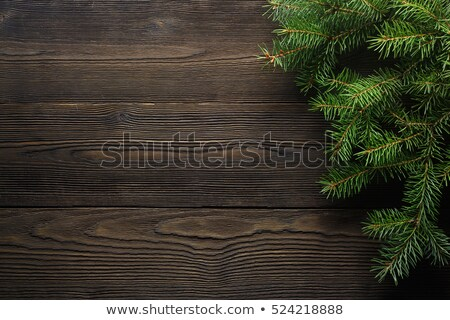 Christmas fir tree with decoration on dark wooden background stock photo © yelenayemchuk
