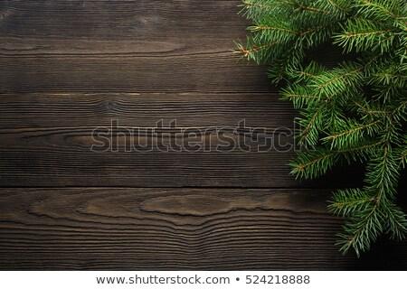 Karácsony fenyőfa dekoráció sötét fából készült fa Stock fotó © yelenayemchuk