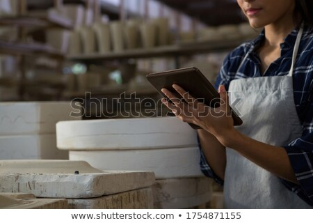 Mid section of female potter using digital tablet Stock photo © wavebreak_media