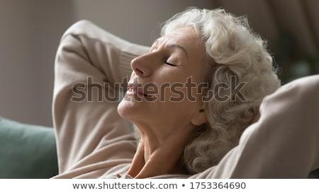 mulher · adormecido · sofá · horizontal - foto stock © wavebreak_media