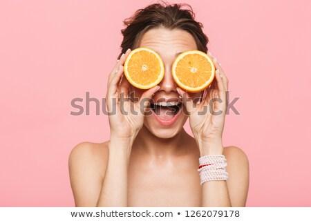 Vrouw oranje glimlachend jonge hand Stockfoto © Lupen