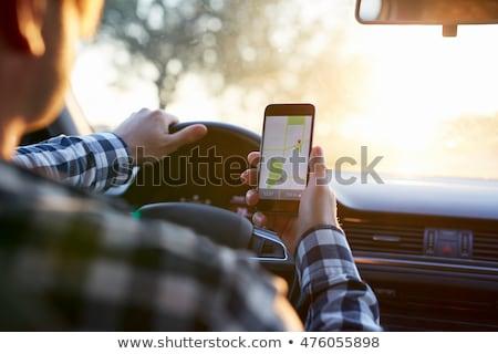Férfi GPS navigáció mobiltelefon autó kezek Stock fotó © stevanovicigor