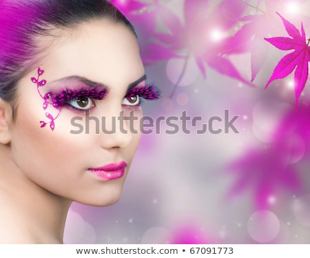 beautiful girl with purple makeup and flowers Stock photo © svetography
