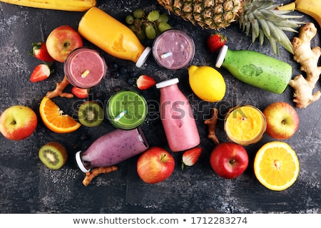 Bottle of healthy red fruit juice smoothie Stock photo © DenisMArt