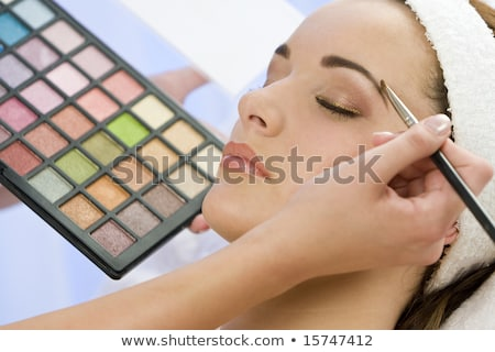 Young Woman Having Her Lipstick Applied stock photo © monkey_business