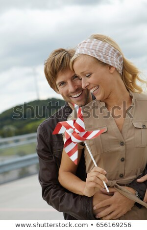 Couple holding handheld windmill Stock photo © IS2