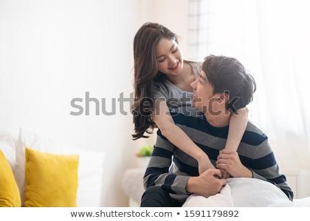 Fiatal szerelmespár nő férfi otthon ül Stock fotó © Kzenon