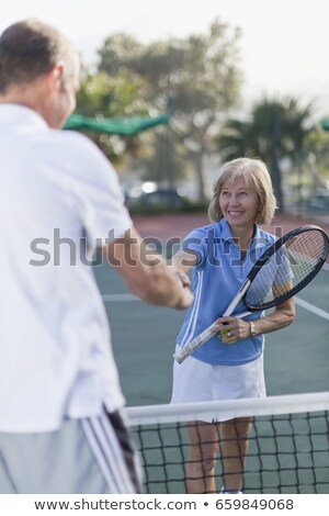 Casal em pé quadra de tênis amor homem Foto stock © IS2