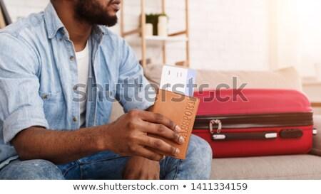 Afroamerikai férfi utazás táska jegy kezek fekete Stock fotó © studioworkstock