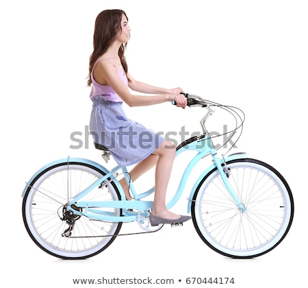 Pretty young woman rides a bike isolated Stock photo © tiKkraf69