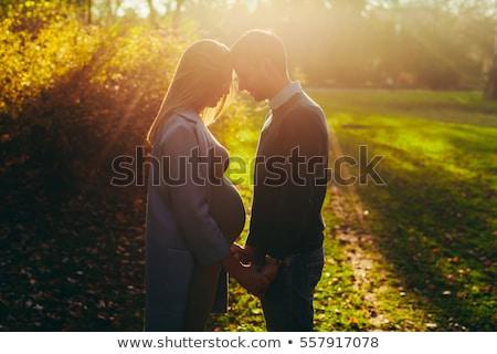 妊婦 愛する 男 ポーズ 秋 公園 ストックフォト © boggy