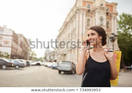 Młoda kobieta ulicy dar portret stałego Zdjęcia stock © IS2