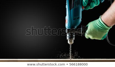 Wiercenia wiercenie deska warsztaty zawód stolarstwo Zdjęcia stock © dolgachov