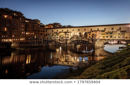 Ponte Vecchio bridge and Arno river waterfront in Florence eveni Stock photo © xbrchx