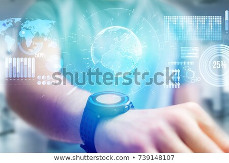 hand with smart watch and earth hologram stock photo © dolgachov