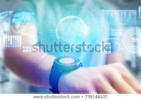 Kéz okos óra Föld hologram üzlet Stock fotó © dolgachov