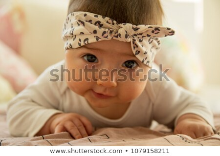 happy beautiful baby girl with bow headband Stock photo © svetography