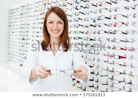 Optikus bemutat szemüveg férfi szemorvos új Stock fotó © Amaviael