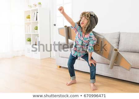 young astronaut playing in game room stock photo © jossdiim