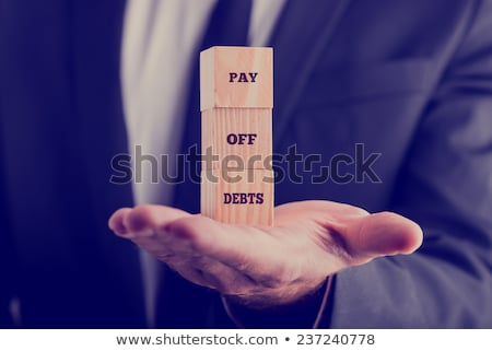 Stock photo: Businessman paying off his debts and loans