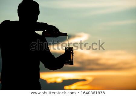 fiatalember · ebédlő · jóképű · férfi · pezsgő · üveg · luxus - stock fotó © deandrobot