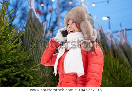 Donna chiamando smartphone albero di natale persone stagione Foto d'archivio © dolgachov