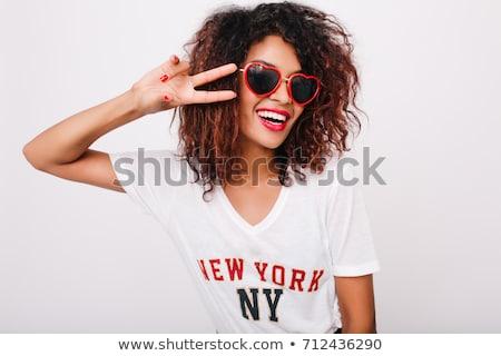 Portrait excité jeune fille cheveux bouclés regarder Photo stock © deandrobot