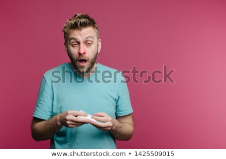 Young man suffering from allergy isolated on white Stock photo © Elnur
