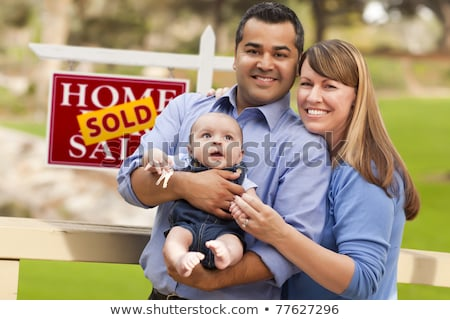 Happy Mixed Race Family In Front of House and Sold For Sale Real Stock photo © feverpitch